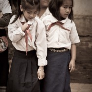 Traditional Laotian skirts and obligatory red scarfs