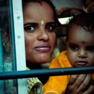 Indian Mother, portrait through the train window